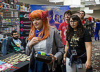 NWA Democrat-Gazette/CHARLIE KAIJO Anime fans check out displays on Sunday, November 12, 2017 at Four Points Sheraton Hotel in Bentonville. The Hotel hosted the Arkansas Anime Festival - Northwest Arkanas Edition 2017. Fans enjoyed product displays, gaming parties and artist Q&As