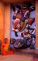A Buddhist Monk meditating in front of a temple in Vientiane, Laos