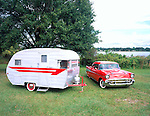1957 Chevrolet parked next to a 1957 Comet canned ham trailer.