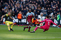 29th February 2020; London Stadium, London, England; English Premier League Football, West Ham United versus Southampton; Michail Antonio of West Ham United taking a shot past Goalkeeper Alex McCarthy of Southampton who gets enough on the ball to make a save