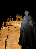 "Low angle view of statue of Padre Vitoria, outside the Convent of St. Stephen, Salamanca, Spain, pictured on December 19, 2010 at night, floodlit. Commissioned by order Juan Alvarez de Toledo, Bishop of Cordoba, and designed by Juan de Alava, the church was built 1525-1618. The main portal, c.1660, has a row of decorated arches and a tympanum with a relief of the ""Martyrdom of St. Stephen"", by Juan Antonio Ceroni. Above it is a frieze in Italian style, depicting Calvary crowned by the Eternal Father. Salamanca, an important Spanish University city, is known as La Ciudad Dorada (""The golden city"") because of the unique golden colour of its Renaissance sandstone buildings. Founded in 1218 its University is still one of the most important in Spain. Around it the Old Town is a UNESCO World Heritage Site. Picture by Manuel Cohen"