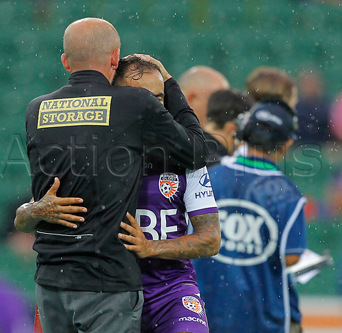 25th March 2018, nib Stadium, Perth, Australia; A League football, Perth Glory versus Melbourne Victory; Kenny Lowe coach of Perth Glory greets Diego Castro after he was substituted during the second half