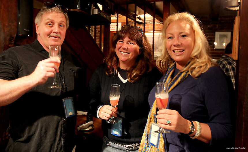 Drinking fresh fruit Bumdingers cocktails at the Dolphin Striker are, from left, Cliff Doyle of Portsmouth, Michele Dubal of Eliot, ME, and Siobhan Hyman of Portsmouth, during the 6th Annual Portsmouth Cocktail Competition in Portsmouth, N.H., Sunday, June 3, 2012.  (Portsmouth Herald Photo Cheryl Senter)