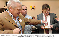 Just a spoonful of sugar....Paidi O'Se puts some sugar in Taoiseach Brian Cowen's cup  during a tea break from the constituency visit to Dingle in County Kerry..Picture by Don MacMonagle
