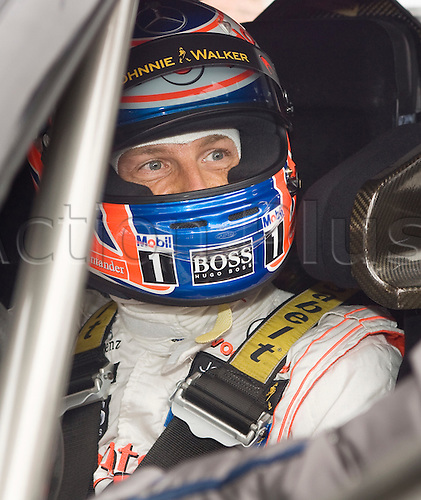 20.05.2012 Brands Hatch, Mercedes F1 driver Jenson Button behind the wheel of Gary Paffaet's C-Coupe before Sunday's Raceday in the 2012 DTM Championship, Kent, England
