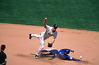 SAN FRANCISCO, CA - Jeff Kent of the San Francisco Giants turns a double play at second base against the Chicago Cubs during a game at AT&T Park in San Francisco, California in 2002. Photo by Brad Mangin