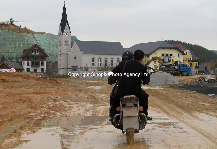20120116 CHINA GUANGDONG PROVINCE : A motorcycle is seen in Hallstatt, China's copy of the Austrian alpine town of the same name, Boluo Township, Huizhou City, Guangdong Province, China, 16 January 2012. Property developments such as this are expected to run into financial difficulites in 2012 as the Chinese economy and property market continue to cool, in reaction to the ongoing sovereign debt crisis in Europe.<br /> SINOPIX / ALEX HOFFORD