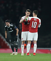Arsenal's Laurent Koscielny hands the captain's armband to Mesut Ozil<br /> <br /> Photographer Rob Newell/CameraSport<br /> <br /> UEFA Europa League Group E - Arsenal v FK Qarabag - Thursday 13th December 2018 - Emirates Stadium - London<br />  <br /> World Copyright © 2018 CameraSport. All rights reserved. 43 Linden Ave. Countesthorpe. Leicester. England. LE8 5PG - Tel: +44 (0) 116 277 4147 - admin@camerasport.com - www.camerasport.com