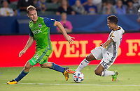 Carson, CA - Saturday July 29, 2017: Chad Marshall, Giovani dos Santos during a Major League Soccer (MLS) game between the Los Angeles Galaxy and the Seattle Sounders FC at StubHub Center.