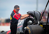 Apr 21, 2018; Baytown, TX, USA; Steve Okuhara crew member for NHRA top fuel driver Leah Pritchett during qualifying for the Springnationals at Royal Purple Raceway. Mandatory Credit: Mark J. Rebilas-USA TODAY Sports
