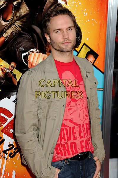 """SCOTT PORTER .""""The Losers"""" Los Angeles Premiere held at Grauman's Chinese Theatre, Hollywood, California, USA, .20th April 2010..half length red t-shirt green shirt beard facial hair jacket khaki beige .CAP/ADM/BP.©Byron Purvis/AdMedia/Capital Pictures."""