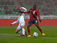 Jozy Altidore (r) of team USA, against Bojan Jokic (l, SLO) during the friendly match Slovenia against USA at the Stozice Stadium in Ljubljana, Slovenia on November 15th, 2011.
