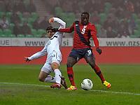 Jozy Altidore (r) of team USA, against Bojan Jokic (l, SLO) during the friendly match Slovenia against USA at the Stozice Stadium in Ljubljana, Slovenia on November 15th, 2011.