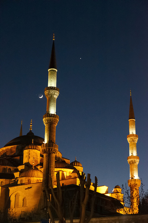A royal blue sky and moon provide the perfect backdrop to night-illuminated Blue Mosque in Istanbul.