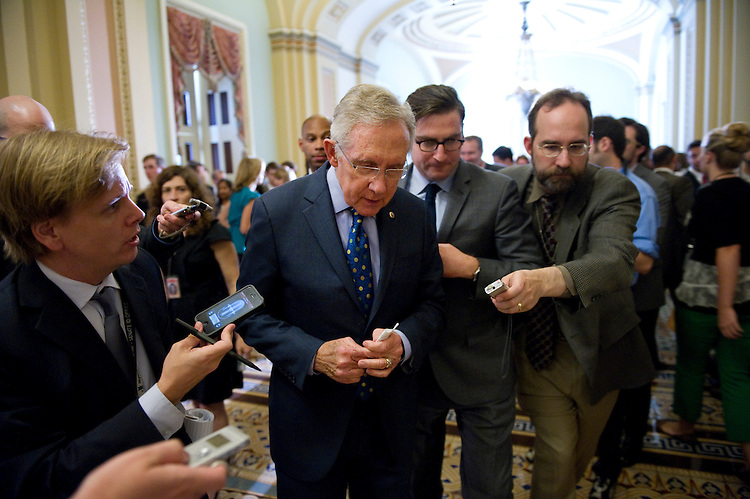 UNITED STATES - JUNE 19: Senate Majority Leader Harry Reid, D-Nev., is interviewed by the press during the weekly Senate policy luncheons. (Photo by Chris Maddaloni/CQ Roll Call)