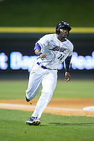 Keon Barnum (20) of the Winston-Salem Dash rounds third base on his way to scoring a run against the Potomac Nationals at BB&T Ballpark on April 30, 2015 in Winston-Salem, North Carolina.  The Nationals defeated the Dash 5-4..  (Brian Westerholt/Four Seam Images)