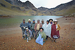 Local community members pose by a polluted lake below the Kumurana Mine near Caiza D, Bolivia. The mine, which is closed, produces highly toxic acid runoff that negatively impacts the farms and lives of people living downstream. Residents are working with an international coalition of scientists and activists to clean up the mine's runoff.