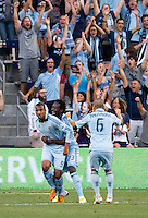Teal Bunbury (9) of Sporting Kansas City celebrates his goal with teammates Kei Kamara (23) during the game at Livestrong Sporting Park in Kansas City, Kansas.  D.C. United lost to Sporting Kansas City, 1-0.
