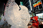 Artists carve ice sculptures along the main drag of the Suskino district .during the Sapporo Snow and Ice Festival in Sapporo City, northern Japan. Around 2 million people visit the city to see the hundreds of hand-crafted snow and ice sculptures that have graced the Sapporo Snow and Ice Festival since its inception in 1950.