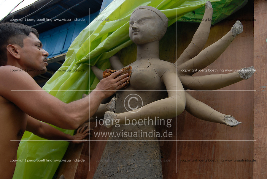 "Asien Suedasien Indien Westbengalen Megacity Kalkutta - Kunsthandwerker im Stadtteil Kumartuli formen Goetterfiguren wie Durga und Kali aus Lehm fuer religioese festivals - Religion Handwerk Kunst Kultur xagndaz | .South asia India Westbengal Calcutta Kolkatta, artist at Kumartuli make god idol for Hindu festival - Megacities religion  .| [ copyright (c) Joerg Boethling / agenda , Veroeffentlichung nur gegen Honorar und Belegexemplar an / publication only with royalties and copy to:  agenda PG   Rothestr. 66   Germany D-22765 Hamburg   ph. ++49 40 391 907 14   e-mail: boethling@agenda-fototext.de   www.agenda-fototext.de   Bank: Hamburger Sparkasse  BLZ 200 505 50  Kto. 1281 120 178   IBAN: DE96 2005 0550 1281 1201 78   BIC: ""HASPDEHH"" ,  WEITERE MOTIVE ZU DIESEM THEMA SIND VORHANDEN!! MORE PICTURES ON THIS SUBJECT AVAILABLE!!  ] [#0,26,121#]"