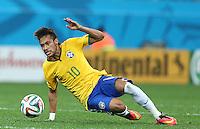 Neymar of Brazil slips as he dribbles with the ball