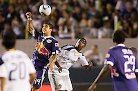 LA Galaxy forward Edson Buddle and New York Red Bulls defender Carlos Mendes battle. The New York Red Bulls beat the LA Galaxy 2-0 at Home Depot Center stadium in Carson, California on Friday September 24, 2010.