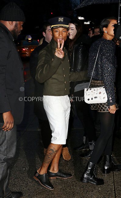 WWW.ACEPIXS.COM<br /> <br /> March 31 2015, New York City<br /> <br /> Pharrell Williams arriving at the Chanel Paris-Salzburg 2014/15 Metiers d'Art Collection at the Park Avenue Armory on March 31, 2015 in New York City. <br /> <br /> By Line: Zelig Shaul/ACE Pictures<br /> <br /> ACE Pictures, Inc.<br /> tel: 646 769 0430<br /> Email: info@acepixs.com<br /> www.acepixs.com