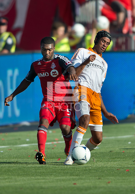 28 July 2012: Houston Dynamo forward Calen Carr #3 and Toronto FC defender Ashtone Morgan #5 in action during an MLS game between Toronto FC and the Houston Dynamo at BMO Field in Toronto,Ontario Canada..The Houston Dynamo won 2-0...