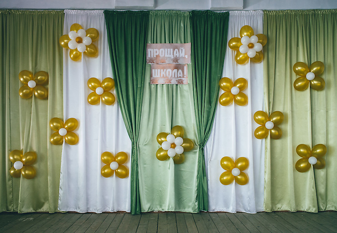 School stage prepared for attending students performance to their teachers. Ribnita, Transnistria.