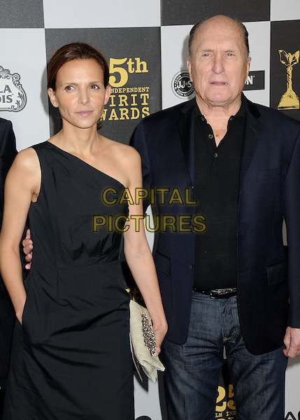LUCIANA PEDRAZA & ROBERT DUVALL.25th Annual Film Independent Spirit Awards - Arrivals held at the Nokia Event Deck at L.A. Live, Los Angeles, California, USA..March 5th, 2010.half length one shoulder dress blue suit jacket married husband wife black  .CAP/ADM/BP.©Byron Purvis/AdMedia/Capital Pictures.