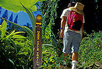 Hiker passes entrance to Manoa Falls trail, near Honolulu
