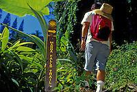 Hiker passes entrance to Manoa Falls trail, near Honolulu