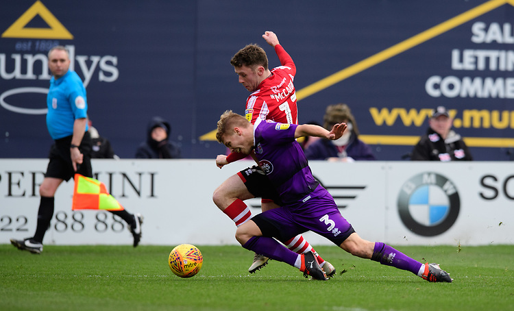 Lincoln City's Shay McCartan vies for possession with Grimsby Town's Sebastian Ring<br /> <br /> Photographer Chris Vaughan/CameraSport<br /> <br /> The EFL Sky Bet League Two - Lincoln City v Grimsby Town - Saturday 19 January 2019 - Sincil Bank - Lincoln<br /> <br /> World Copyright &copy; 2019 CameraSport. All rights reserved. 43 Linden Ave. Countesthorpe. Leicester. England. LE8 5PG - Tel: +44 (0) 116 277 4147 - admin@camerasport.com - www.camerasport.com