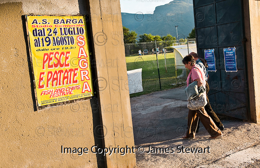 SAGRA DEL &quot;PESCE E PATATE&quot; 2011, BARGA, ITALY<br /> <br /> LOCALS ARRIVES AT THE STADIO COMUNALE &quot;JOHNNY MOSCARDINI&quot;, HOME OF A.S. BARGA AND THE LOCATION OF THE SAGRA DEL &quot;PESCE E PATATE&quot; 2011