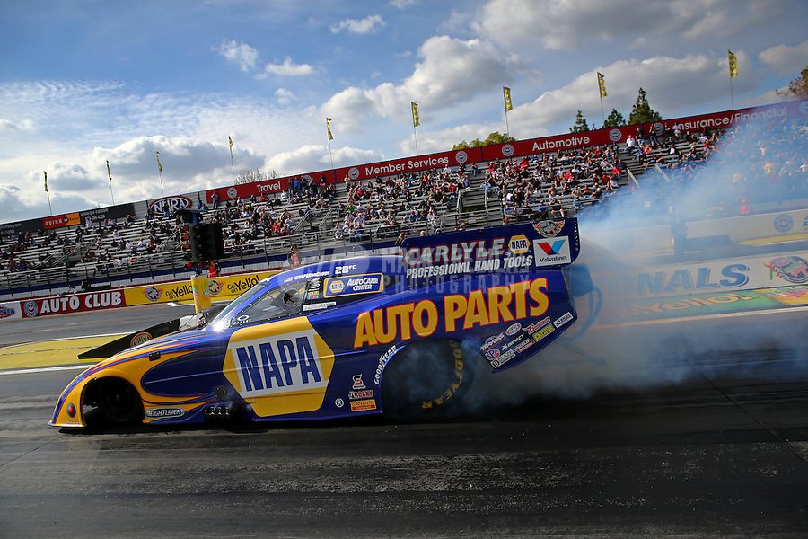 Feb 7, 2014; Pomona, CA, USA; NHRA funny car driver Ron Capps during qualifying for the Winternationals at Auto Club Raceway at Pomona. Mandatory Credit: Mark J. Rebilas-