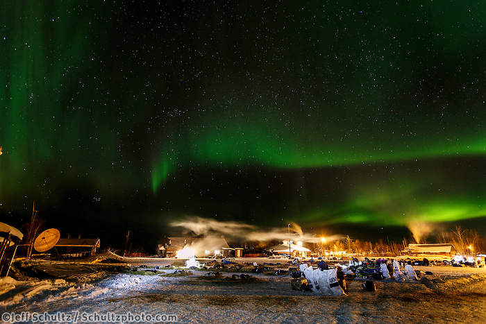 Northern Lights dance overhead of resting teams at the Huslia checkpoint early on Sunday  March 15, 2015 during Iditarod 2015.  <br /> <br /> (C) Jeff Schultz/SchultzPhoto.com - ALL RIGHTS RESERVED<br />  DUPLICATION  PROHIBITED  WITHOUT  PERMISSION