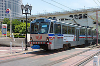 A Regional Transit Authority (RTA) train passes through Settlers Landing Station in the Flats area of Cleveland, Ohio.  The train consists of an articulated Breda Light Rail Vehicle (LRV) purchased in 1981.
