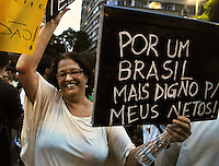 "People shouts slogans riots on the streets of Rio to protest against official corruption and spending on next year's World Cup, Rio de Janeiro, Brasil, June 20, 2013. In the banner says: ""For one Brazil more worthy for my grandsons"".  (Austral Foto/Renzo Gostoli)"