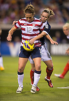 Lauren Cheney (12) of the USWNT fights for the ball with Eilish McSorley (4) of Scotland during the game at EverBank Field in Jacksonville, Florida.  The USWNT defeated Scotland, 4-1.