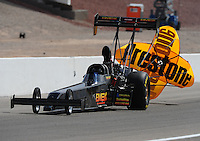 Apr. 2, 2011; Las Vegas, NV, USA: NHRA top fuel dragster driver Troy Buff during qualifying for the Summitracing.com Nationals at The Strip in Las Vegas. Mandatory Credit: Mark J. Rebilas-