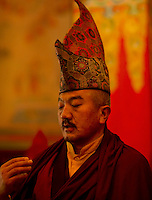 Head Lama conducts the prayer ceremony inside Lingdum monastery, Sikkim, India