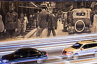 Urban art, contrast between ancient and modern city, Old photograph on wall beside heavy traffic of 23 de maio avenue in São Paulo, Brazil.