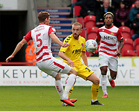 Fleetwood Town's Paddy Madden squeezes the ball past Doncaster Rovers' Joe Wright<br /> <br /> Photographer David Shipman/CameraSport<br /> <br /> The EFL Sky Bet League One - Doncaster Rovers v Fleetwood Town - Saturday 6th October 2018 - Keepmoat Stadium - Doncaster<br /> <br /> World Copyright &copy; 2018 CameraSport. All rights reserved. 43 Linden Ave. Countesthorpe. Leicester. England. LE8 5PG - Tel: +44 (0) 116 277 4147 - admin@camerasport.com - www.camerasport.com