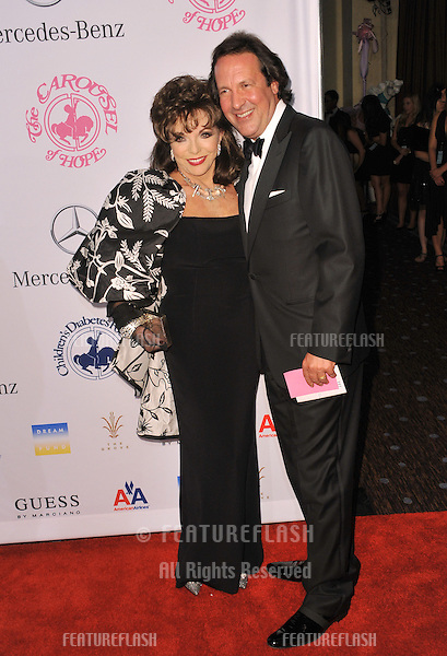 Joan Collins & husband Percy Gibson at the 26th Carousel of Hope Gala at the Beverly Hilton Hotel..October 20, 2012  Beverly Hills, CA.Picture: Paul Smith / Featureflash