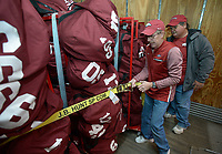 NWA Democrat-Gazette/ANDY SHUPE<br />Jerry Rico (right) of Fayetteville and Rodney Collins of Pensacola, Fla.,secure carts of players' equipment Thursday, Nov. 9, 2017, into a 53-foot semi-trailer before heading out to Baton Rouge, La., ahead of the Razorbacks' game with LSU Saturday. Rico and Collins are employees of J.B. Hunt Transport and the work together to drive equipment necessary for the Razorbacks football team to and from games away from Fayetteville.