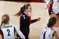 STANFORD, CA - September 2, 2010: Gabi Ailes cheers during a volleyball match against UC Irvine in Stanford, California. Stanford won 3-0.