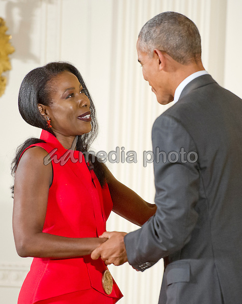 United States President Barack Obama presents the 2015 National Humanities Medal to Isabel Wilkerson, Journalist & Author of Atlanta, Georgia, during a ceremony in the East Room of the White House in Washington, DC on Thursday, September 22, 2016. Photo Credit: Ron Sachs/CNP/AdMedia
