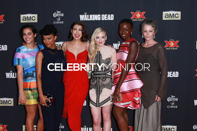 UNIVERSAL CITY, CA, USA - OCTOBER 02: Alanna Masterson, Sonequa Martin-Green, Lauren Cohan, Emily Kinney, Danai Gurira, and Melissa McBride arrive at the Los Angeles Premiere Of AMC's 'The Walking Dead' Season 5 held at AMC Universal City Walk on October 2, 2014 in Universal City, California, United States. (Photo by David Acosta/Celebrity Monitor)