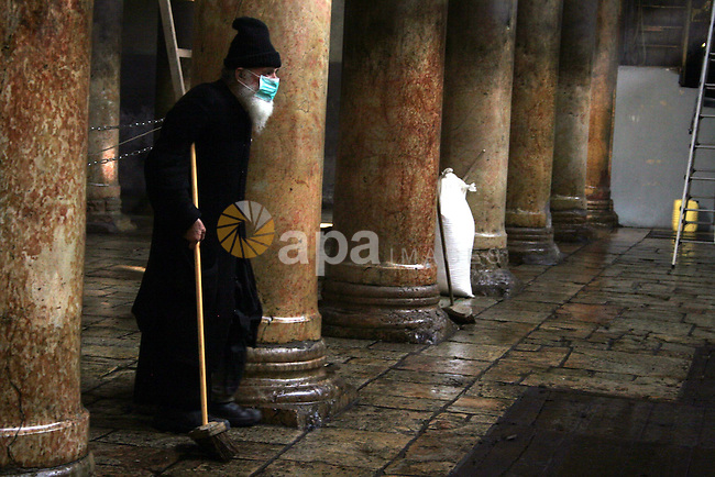 Orthodox priests cleans the Church of the Nativity in the biblical West Bank city of Bethlehem on December 29, 2009 as part of the preparations for the Orthodox faith's Christmas celebrations. The Orthodox faith in the holy land uses the old Julian calendar in which Christmas falls 13 days after the more widespread Gregorian calendar date of December 25.Photo by Najeh Hashlamoun