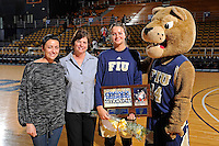 25 February 2012:  FIU senior guard Sasha Melnikova (5), pictured with a relative and Head Coach Cindy Russo, is honored in a ceremony prior to the game.  The FIU Golden Panthers defeated the University of South Alabama Jaguars, 58-55 (OT), at the U.S. Century Bank Arena in Miami, Florida.